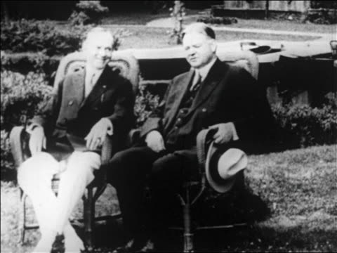 president calvin coolidge herbert hoover sitting outdoors on chairs / newsreel - 1928 stock-videos und b-roll-filmmaterial