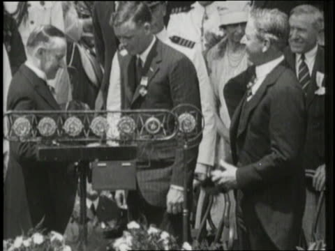 president calvin coolidge pins a distinguished flying cross medal on charles lindbergh - charles lindbergh stock videos & royalty-free footage
