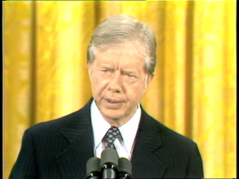 vídeos de stock, filmes e b-roll de us president carter at press conference giving remarks on nation's economy adult caucasian and africanamerican male and female members of the media... - self discipline