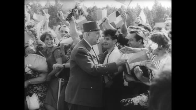 president charles de gaulle arrives at moscow airport in military uniform for 12 day state visit to russia / de gaulle and wife yvonne are greeted by... - cold war stock videos & royalty-free footage
