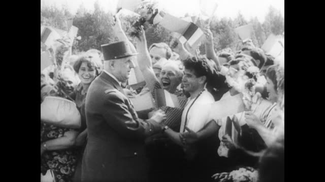 president charles de gaulle in moscow to reduce tension between east and west / walks along edge of crowd shaking hands and smiling at public / car... - charles de gaulle stock videos & royalty-free footage
