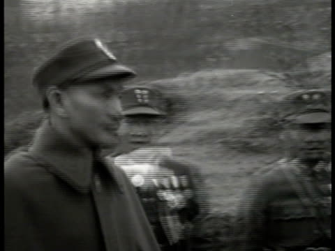 president chiang kaishek walking w/ officers on street saluting ms kaishek reviewing chinese soldiers fg ha ws kaishek walking w/ officials world war... - chiang kai shek stock-videos und b-roll-filmmaterial