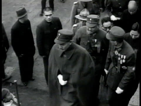 president chiang kaishek wearing cap white gloves walking w/ others up steps ms president chiang kaishek walking among talking to soldiers wwii... - chiang kai shek stock-videos und b-roll-filmmaterial