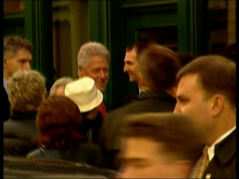 final day of visit/trip to Notting Hill POOL US President Bill Clinton talking and shaking hands with people on street Clinton and wife Hillary with...
