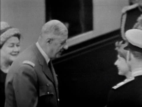 president de gaulle and his wife disembark from the train at victoria station and are greeted by the queen prince philip and princess margaret at the... - wife stock videos & royalty-free footage