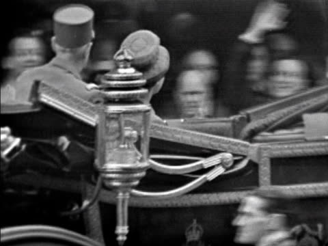 president de gaulle salutes the cheering crowds as the open top carriage carrying him and the queen leave victoria station 05 april 1960 - charles de gaulle stock videos and b-roll footage