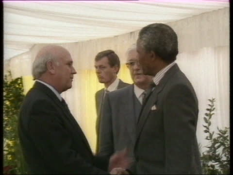 president de klerk and nelson mandela shake hands at first public meeting since his release - president stock videos & royalty-free footage