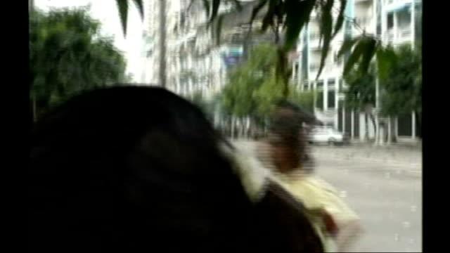 president 'deeply disturbed' by un report on burma military repression; *uk rights only, no international use* september 2007 burma: rangoon: ext... - ミャンマー点の映像素材/bロール