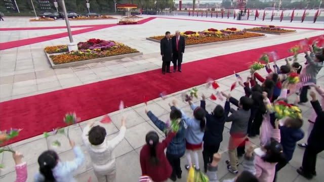 president donald trump and chinese president xi jinping walk by a crowd of cheering children during a welcoming ceremony in beijing, china. - beijing stock videos & royalty-free footage