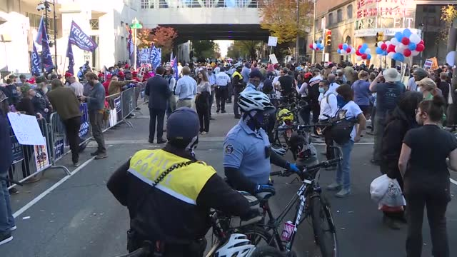 president donald trump and democratic presidential nominee joe biden supporters have been waiting in front of vote count center in philadelphia on... - philadelphia pennsylvania stock videos & royalty-free footage