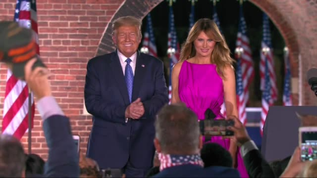 president donald trump and first lady melania clap and point at supporters inside the fort mckinney complex trump raising his thumb before... - melania trump stock videos & royalty-free footage