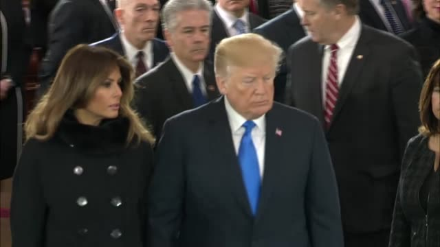 president donald trump and first lady melania trump depart a ceremony in the capitol rotunda as the late reverend billy graham lies in honor on the... - first lady stock-videos und b-roll-filmmaterial