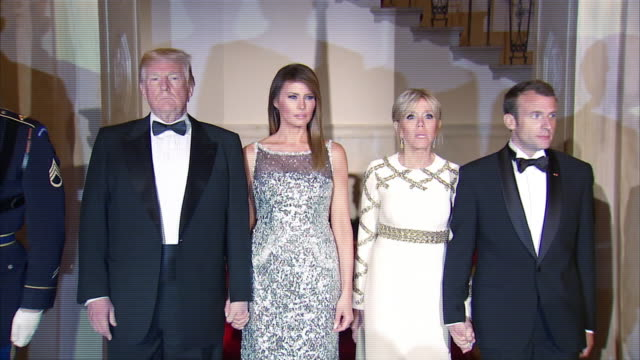 president donald trump and first lady melania trump followed by president emmanuel macron and first lady brigitte macron enter the state dinner - dinner lady stock videos & royalty-free footage