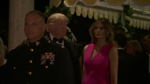 ws president donald trump and first lady melania trump on red carpet at red cross gala at maralago in west palm beach florida dignitaries are lined... - v neck stock videos & royalty-free footage