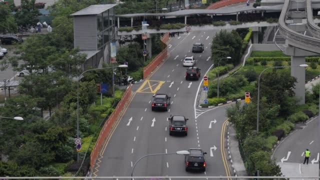 stockvideo's en b-roll-footage met us president donald trump and north korean leader kim jong un are on the road to capella hotel on sentosa where they're going to meet for a summit - a capella