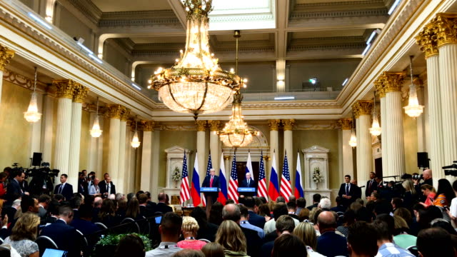 president donald trump and russian president vladimir putin speak to the media during a joint press conference after their summit on july 16 2018 in... - wladimir putin stock-videos und b-roll-filmmaterial