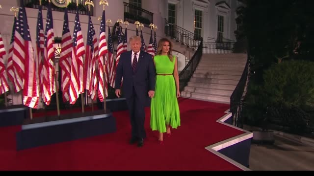 president donald trump and wife melania descend steps among american flags to greet an audience before trump delivers reelection nomination speech... - melania trump stock videos & royalty-free footage