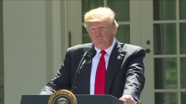 US President Donald Trump announces the US withdrawal from the Paris climate agreement in the Rose Garden at the White House