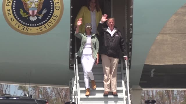 vídeos de stock, filmes e b-roll de president donald trump arrives in hurricane devastated puerto rico hoping to underscore government recovery efforts and repair damage done by his... - porto riquenho