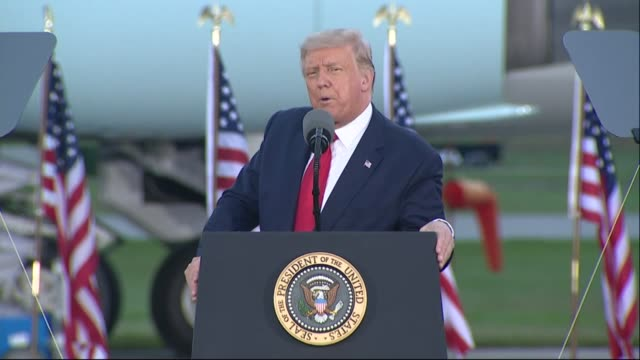 president donald trump asks an audience of supporters at a campaign event at avflight saginaw if anyone wanted somebody from antifa as a member and... - anti fascism stock videos & royalty-free footage