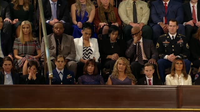 president donald trump at a joint session of congress during his first state of the union address points out parents evelyn rodriguez freddy cuevas... - rede zur lage der nation usa stock-videos und b-roll-filmmaterial