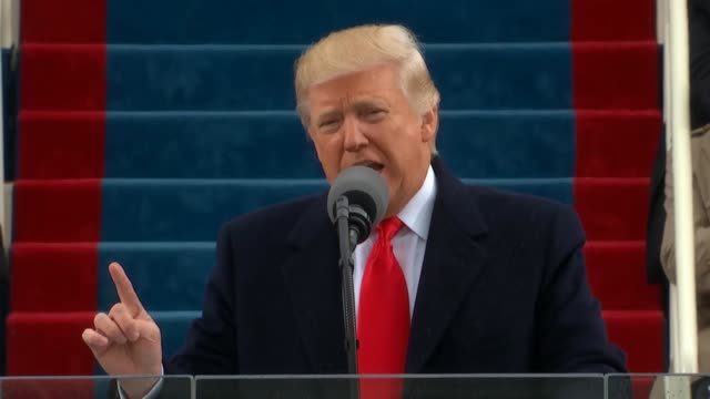 president donald trump delivers his inaugural address from the west front of the capitol telling americans that the military and god would protect... - präsident der usa stock-videos und b-roll-filmmaterial