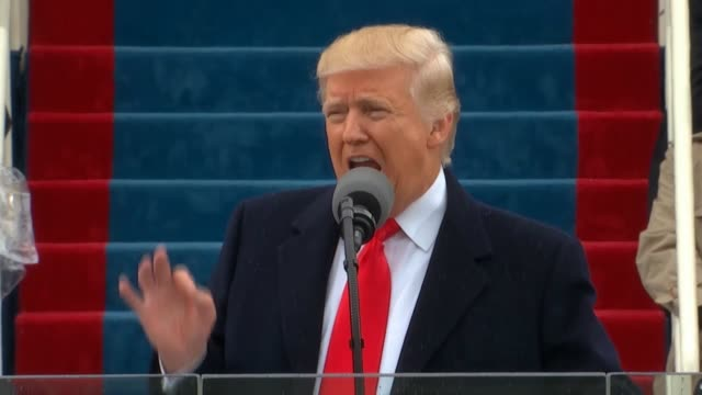 president donald trump delivers his inaugural address to the nation at a ceremony on the west front of the capitol telling americans that it does not... - präsident der usa stock-videos und b-roll-filmmaterial