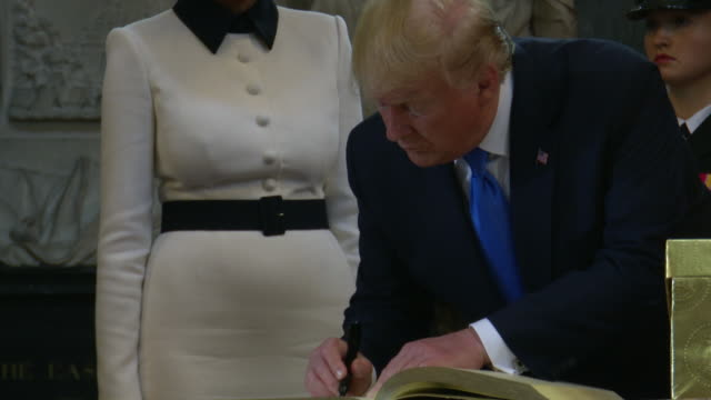 us president donald trump first lady melania trump sign the visitors book at westminster abbey on june 3 2019 in london england - signing stock videos & royalty-free footage