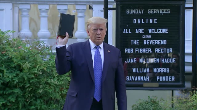 president donald trump hold up the bible outside of st. john's episcopal church during a photo op after his remarks on george floyd at the rose... - bible stock videos & royalty-free footage