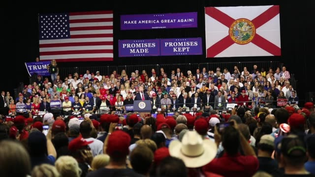 vídeos de stock e filmes b-roll de president donald trump holds a make america great again rally at the florida state fair grounds expo hall on july 31 2018 in tampa florida before the... - comício político
