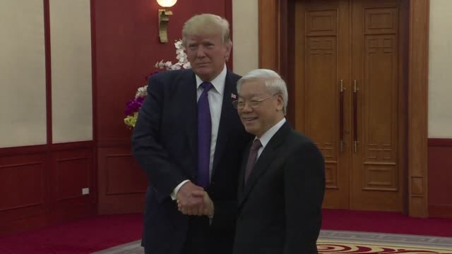 us president donald trump meets vietnam's communist party chief nguyen phu trong during his visit in hanoi - communist party stock videos and b-roll footage