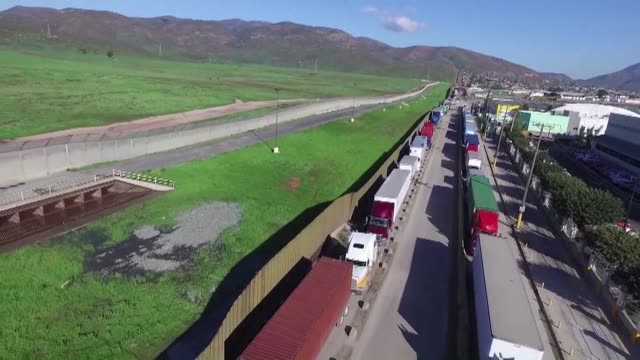 stockvideo's en b-roll-footage met president donald trump on wednesday ordered work to begin on planning and building a wall on the mexican border sounding a hardline tone on... - kleurtoon