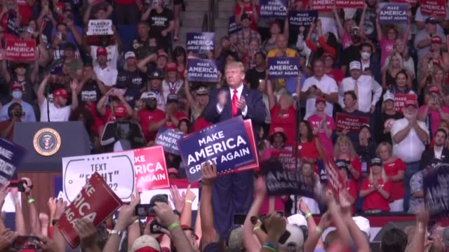 president donald trump return to one of his favorite spots -- a campaign rally stage -- defying the pandemic and attacking democratic rivals at an... - political rally stock videos & royalty-free footage