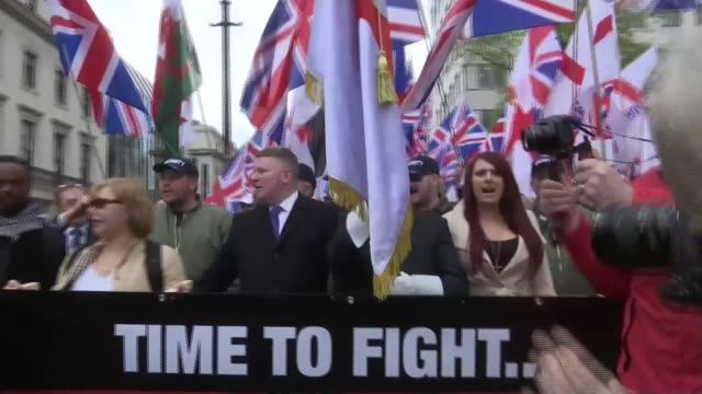 us president donald trump retweets videos from farright group britain first r010417002/ london ext britain first march along behind banner with jayda... - protestor stock videos & royalty-free footage