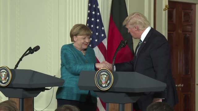 us president donald trump says he backs the nato alliance but with visiting german chancellor angela merkel at his side stresses that some member... - angela merkel stock videos & royalty-free footage