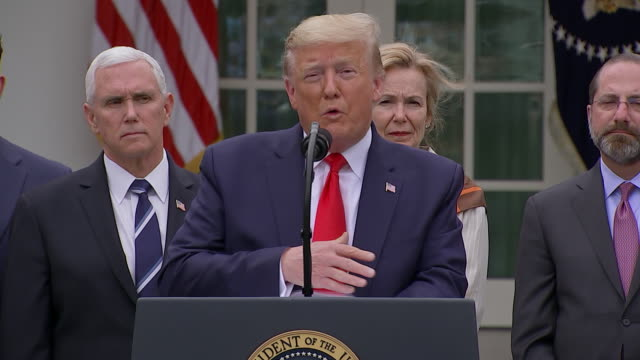 """president donald trump says """"some of the doctors say it will wash through, it will flow through"""" during his remarks on the coronavirus outbreak. - press room stock videos & royalty-free footage"""