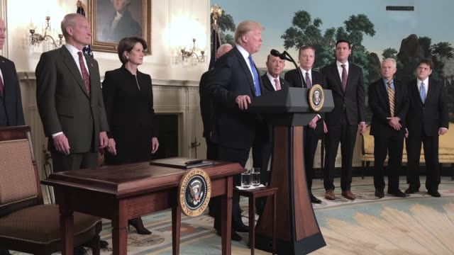 US President Donald Trump speaks before signing a Presidential Memorandum targeting China's economic aggression at the White House on March 22 2018...