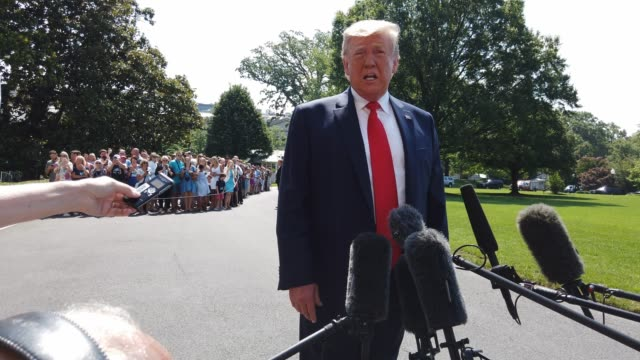 vídeos de stock e filmes b-roll de president donald trump speaks to members of the media about considering an executive order to add a citizenship question to the u.s. census prior to... - cidadão