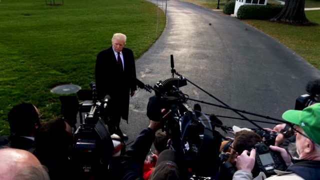 us president donald trump speaks to members of the media prior to his departure from the south lawn of the white house november 20 2018 in washington... - prato rasato video stock e b–roll