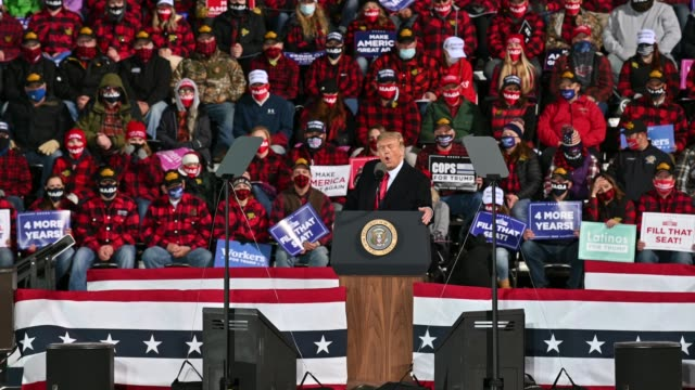 president donald trump speaks to supporters during a rally at the duluth international airport on september 30, 2020 in duluth, minnesota. - political rally stock videos & royalty-free footage