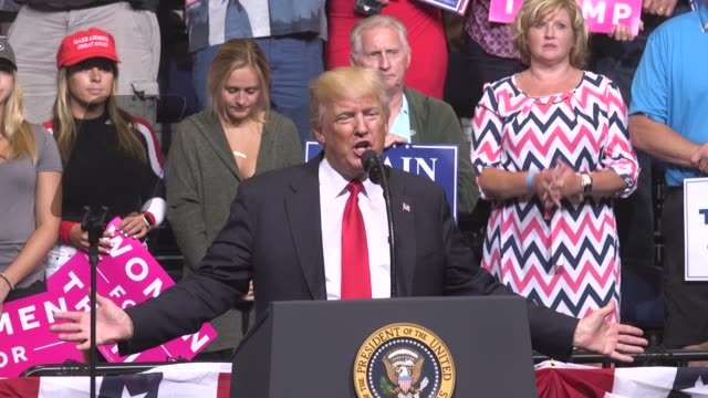 US President Donald Trump talks about how the economy and trade have improved under his watch during a campaign rally in Cedar Rapids Iowa on...