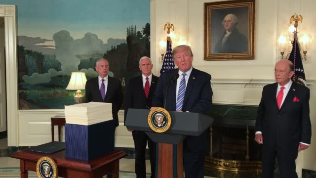 US President Donald Trump talks about signing the spending bill that Congress passed early Friday in the Diplomatic Room of the White House on March...