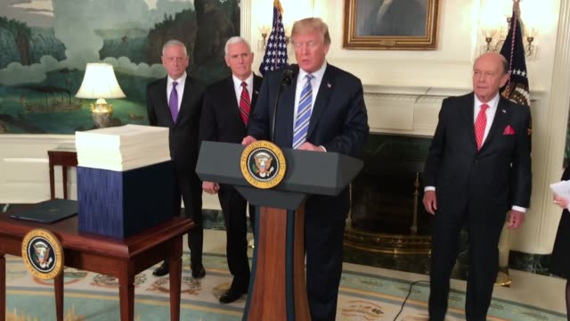 president donald trump talks about signing the spending bill that congress passed early friday, in the diplomatic room of the white house, on march... - la casa bianca washington dc video stock e b–roll