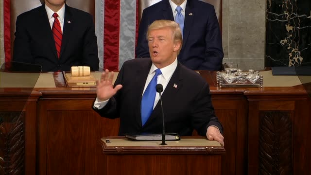 president donald trump tells a joint session of congress during his first state of the union address that no regime had oppressed its own citizens... - 残酷点の映像素材/bロール