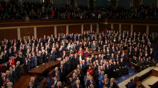 president donald trump tells a joint session of congress during his first state of the union address that 320 million hearts were breaking for... - kongressversammlung stock-videos und b-roll-filmmaterial