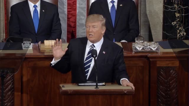 vídeos de stock e filmes b-roll de president donald trump tells a joint session of congress that a new sense of national pride is flowing across the country as the united states... - presidente