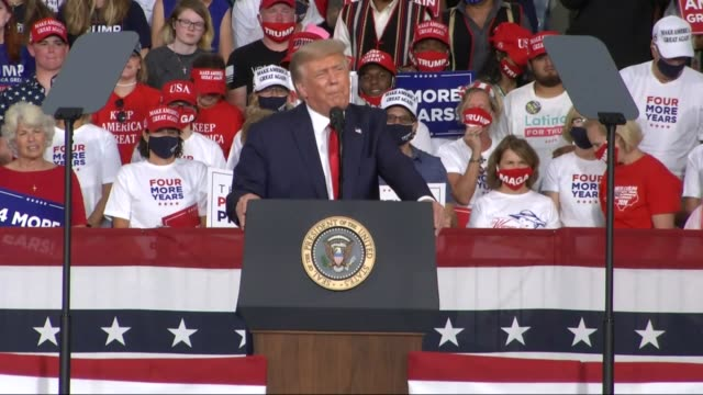 president donald trump tells an audience of supporters at a campaign event at smith reynolds regional airport that the year before in 2019 america... - carolina del nord stato usa video stock e b–roll