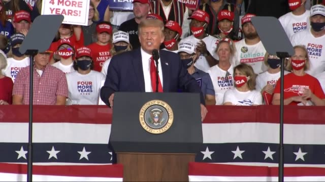 president donald trump tells an audience of supporters at a campaign event at smith reynolds regional airport that joe biden supports cutting police... - portland oregon点の映像素材/bロール