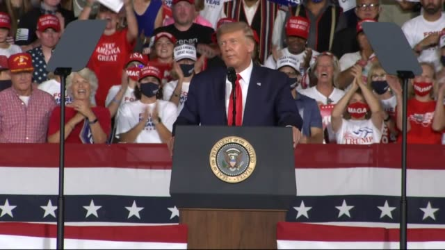 president donald trump tells an audience of supporters at a campaign event at smith reynolds regional airport that he once was getting calls from... - charlotte stock-videos und b-roll-filmmaterial