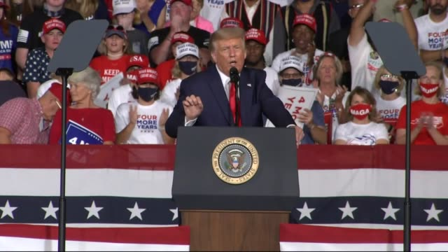 president donald trump tells an audience of supporters at a campaign event at smith reynolds regional airport that all stand on the shoulders of... - 飼い慣らされた点の映像素材/bロール